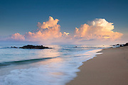 Cumulonimbus storm clouds build over the Pacific Ocean near Sayulita, Mexico at sunrise.