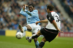 MANCHESTER, ENGLAND - Saturday, March 27, 2004: Manchester City's Sean Wright-Phillips and Fulham's Carlos Bocanegra during the Premiership match at the City of Manchester Stadium. (Pic by David Rawcliffe/Propaganda)