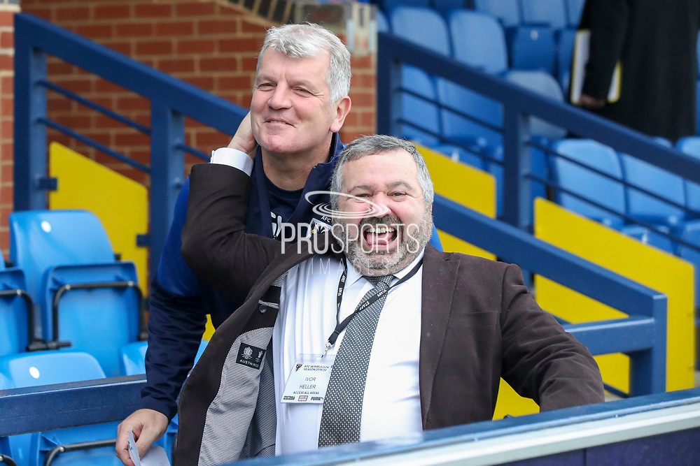 AFC Wimbledon manager Glyn Hodges playing around and having some fun with Ivor Heller during the EFL Sky Bet League 1 match between AFC Wimbledon and Southend United at the Cherry Red Records Stadium, Kingston, England on 1 January 2020.