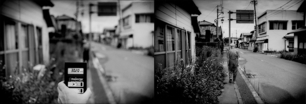 L: Standing on a hot spot, in a garden in front of a Iitate-mura house, on a road that has already been decontaminated.  Residents may return to their homes but cannot live in the village due to high levels of radiation.  Iitate-mura, Fukushima Prefecture, Japan..R: Elderly man walks down a radiation hot spot riddled, street in Iitate-mura, where he lives, despite the fact that the Japanese government has designated the area as a radiation evacuation zone.  It is legal to enter Iitate-mura but residents are not permitted to spend the night in the town, which was irradiated after explosions at Fukushima Daiichi nuclear power plant.  Iitate-mura, Fukushima Prefecture, Japan.
