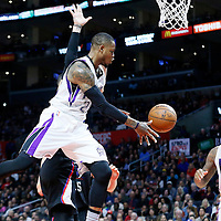 16 January 2016: Sacramento Kings guard Ben McLemore (23) passes the ball around Los Angeles Clippers guard Austin Rivers (25) to Sacramento Kings center DeMarcus Cousins (15) during the Sacramento Kings 110-103 victory over the Los Angeles Clippers, at the Staples Center, Los Angeles, California, USA.