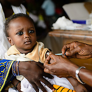 Nine month-old Aboulaye being vaccinated against tetanus and other diseases at a health centre in Guiglo in western Cote d'Ivoire on 13 August 2012.