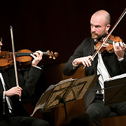 "February 22, 2015 - New York, NY : From left, The Calder Quartet's Ben Jacobson (violin) and Andrew Bulbrook (violin) perform at the Brooklyn Public Library, Central Library as part of Carnegie Hall's ""Neighborhood Concert"" series on Sunday afternoon. CREDIT: Karsten Moran for The New York Times"