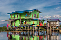 INLE LAKE, MYANMAR - DECEMBER 09, 2016 : floating houses on the canal of the Inle Lake Shan state in Myanmar (Burma)