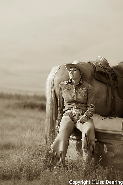 Cowgirl Sitting on Water Trough