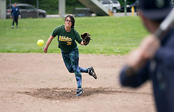 Lyla Weinstein delivers the pitch in the first inning, as the Montclair softball league celebrates its 50th season, Saturday, April 22, 2017, at Montclair Park in Oakland, Calif. The pickup softball game, played every Saturday by a group of enthusiasts ranging in age from 20 to 75, started in 1968 in Berkeley and moved to Montclair about 25 years ago. (Photo by D. Ross Cameron)