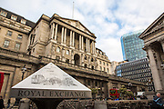 A London street view of the Bank of England, Threadneedle Street, London, United Kingdom.  The Bank of England is the central bank of the United Kingdom.  It was established in 1694 and is the second oldest central bank in the world.  The Bank's headquarters have been in London's main financial district, the City of London since 1734 and it is sometimes know as The Old Lady of Threadneedle Street and is an iconic image of London and monetary policy.
