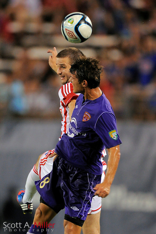 Stoke City Potters midfielder Jamie Ness (8) and Orlando City Lions defender Erik Ustruck (8) go airborne for a ball at the Florida Citrus Bowl on July 28, 2012 in Orlando, Florida. Stoke won 1-0...© 2012 Scott A. Miller.