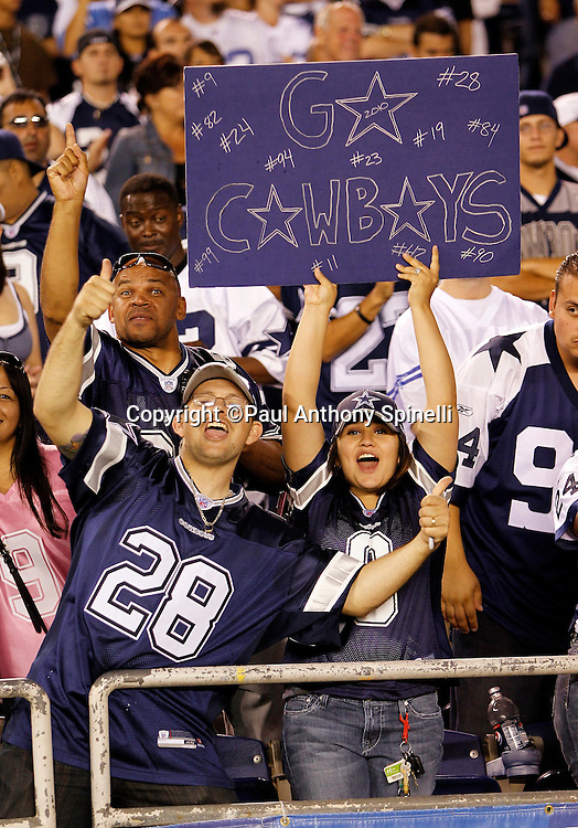 "Dallas Cowboys fans hold up a ""Go Cowboys"" sign and cheer for their team during a NFL week 2 preseason football game against the San Diego Chargers on Saturday, August 21, 2010 in San Diego, California. The Cowboys won the game 16-14. (©Paul Anthony Spinelli)"