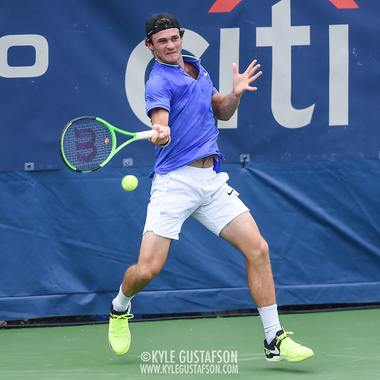 TOMMY PAUL hits a forehand during his second round match at the Citi Open at the Rock Creek Park Tennis Center in Washington, D.C.