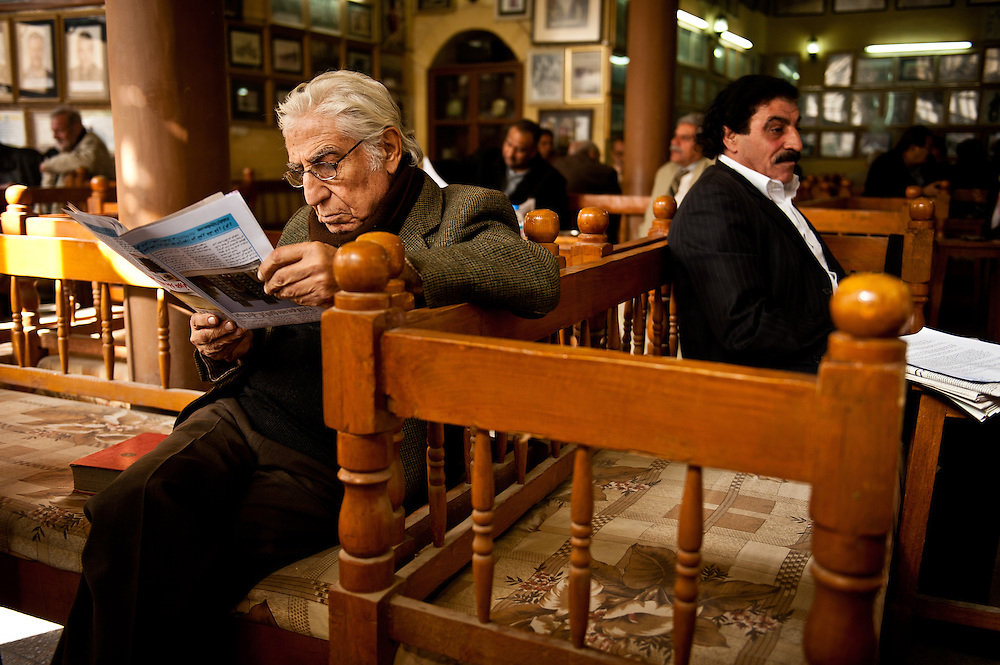 Patrons of the Shabander Café on Al Mutanebbi Street, a famous literary café popular with Baghdad intellectuals, founded in the early 20th Century.