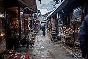 A woman walking through the Baščaršija quarter  - which is Sarajevo's old bazaar and the historical and cultural center of the Bosnian capital city.