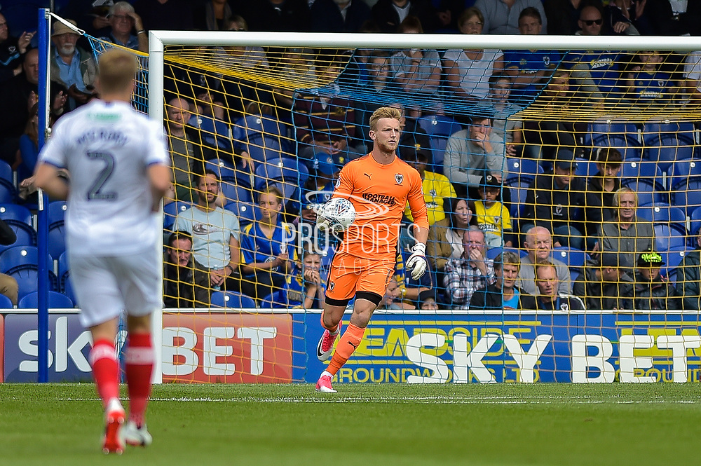 AFC Wimbledon Goalkeeper, George Long (1) collects the ball during the EFL Sky Bet League 1 match between AFC Wimbledon and Portsmouth at the Cherry Red Records Stadium, Kingston, England on 9 September 2017. Photo by Adam Rivers.