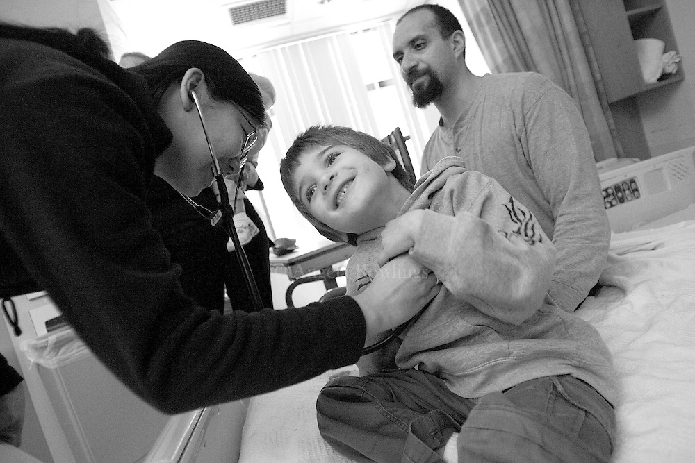 Aidan Sumner, 4, is examined by a resident before being released from Children's Hospital,  February 25, 2008.