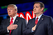 Presidential hopeful Donald Trump (left) and Ted Cruz (R-Tx) during the national anthem before the CNN Republican Presidential Debate at the Venetian Hotel and Casino in Las Vegas.