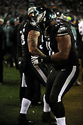 Dec 25, 2017; Philadelphia, PA, USA; Philadelphia Eagles defensive end Jake Long (56) and defensive tackle Fletcher Cox (91) dance on the sdielines during a NFL football game at Lincoln Financial Field. The Eagles defeated the Raiders 19-10. Photo by Reuben Canales