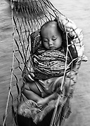 A baby swings in a hammock in a village near the Nam Ou (river), Laos.