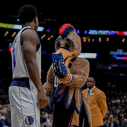 Dec 29, 2017; New Orleans, LA, USA; New Orleans Pelicans mascot Pierre the Pelican offers popcorn to Dallas Mavericks guard Yogi Ferrell (11) during the first quarter at the Smoothie King Center. Mandatory Credit: Derick E. Hingle-USA TODAY Sports
