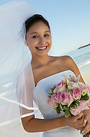 Bride with bouquet on Beach (portrait)