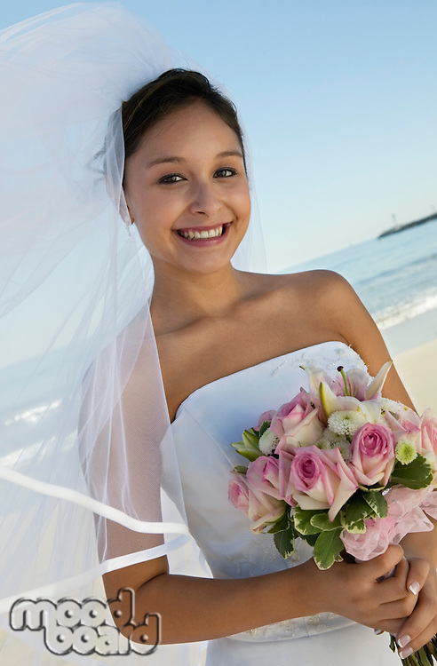 Bride with bouquet on Beach (portrait)