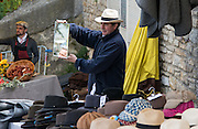 Panama hats, imported from Ecuador and modeled by the seller. Bonnieux Market, France.