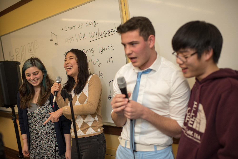 "From left, Tova Beeber, Sphia Chen, Ethan Gritz, and Mathew Chong sing ""Fantastic Baby,"" a Kpop song, at Korean Culture Night in Harris Hall, Feb. 12, 2016 at Northwestern University in Evanston. (Photography by Rob Hart)"