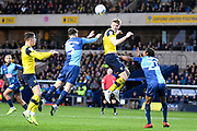 Oxford United defender Rob Dickie (4) heads the ball  under pressure from Wycombe Wanderers defender Joe Jacobson (3) during the EFL Sky Bet League 1 match between Oxford United and Wycombe Wanderers at the Kassam Stadium, Oxford, England on 21 December 2019.