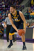 FORT WORTH, TX - JANUARY 4: Nathan Adrian #11 of the West Virginia Mountaineers brings the ball up court against the TCU Horned Frogs on January 4, 2016 at Ed and Ray Schollmaier Arena in Fort Worth, Texas.  (Photo by Cooper Neill/Getty Images) *** Local Caption *** Nathan Adrian