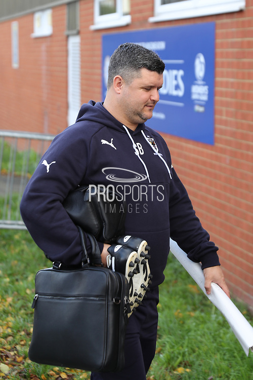 AFC Wimbledon first team coach Simon Bassey  arriving during the EFL Sky Bet League 1 match between AFC Wimbledon and Plymouth Argyle at the Cherry Red Records Stadium, Kingston, England on 21 October 2017. Photo by Matthew Redman.