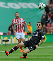 Liverpool's Philippe Coutinho loses the high ball to Stoke City's Marc Muniesa - Photo mandatory by-line: Nizaam Jones/JMP - Mobile: 07966 386802 - 24/05/2015 - SPORT - Football - Stoke - Britannia Stadium - Stoke City v Liverpool - Barclays Premier League