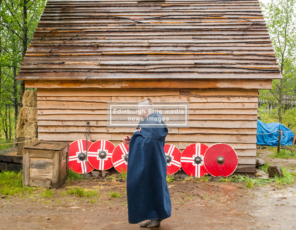 Pictured: Duncarron Medieval Village Opening. Carron Valley Forest, Lanarkshire, 18 May 2019. In authentic Scottish weather, The Clanranald Trust opens a full-scale replica of an early Medieval Fortified Village typical of a Scottish Clan Chief's residence. The open air museum includes traditional buildings such as round houses, a great hall, and tower. The event features music bands and traditional dance.<br /> Sally Anderson   EdinburghElitemedia.co.uk
