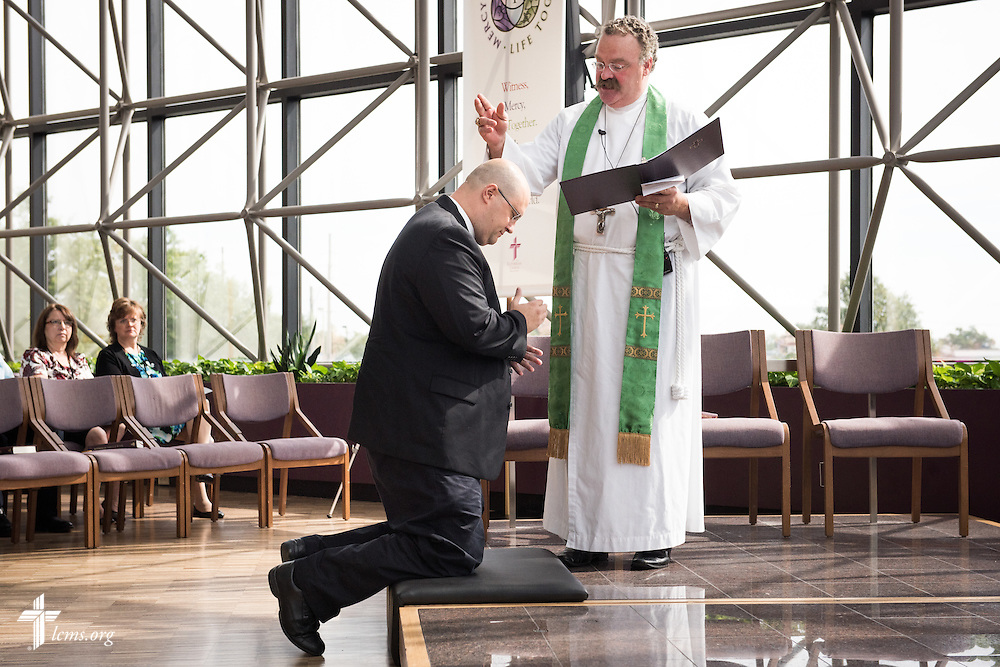 The Rev. Dr. Matthew C. Harrison, president of The Lutheran Church–Missouri Synod, installs the Rev. Marcus Zill, director of Campus Ministry and LCMS U in the Office of National Mission, in the International Center chapel of The Lutheran Church–Missouri Synod on Wednesday, Sept. 3, 2014, in Kirkwood, Mo. LCMS Communications/Erik M. Lunsford