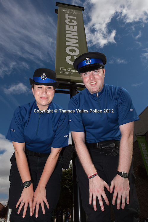 Two PCSOs, sponsored by Oxford Brookes University, pose for a photograph at the Family Events Police Day held at  University by Thames Valley Police. Oxford, UNITED KINGDOM. August 18 2012. <br /> Photo Credit: MDOC/Thames Valley Police<br /> &copy; Thames Valley Police 2012. All Rights Reserved. See instructions.