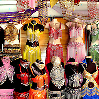 Belly Dancer Outfits on Display in Marmaris, Turkey<br /> If you ever dreamed of being a belly dancer, then several shops in Marmaris, Turkey, can outfit you.  And don't forget to also buy zills, which are tiny finger cymbals that are essential to properly performing the fast, athletic and flamboyant moves of Oryantal Dansi. But don't try this dance in the Middle East where many people consider it to be offensive and even haram, which means it's forbidden by Allah.