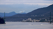 Sea plane flying over Lions Gate Bridge, linking Downtown Vancouver and the North Shore.