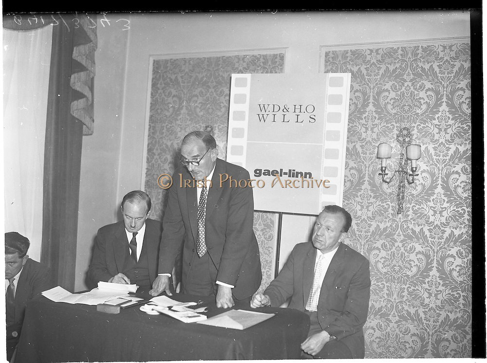 "30/05/1960<br /> 05/30/1960<br /> 30 May 1960<br /> W.D. & H.O. Wills and Gael Linn press conference on new collaboration at the Hibernian Hotel Dublin. Image shows (l-r): Donall Ó Móráin, Chairman Gael Linn; Mr A. Pullan, Sales Manager W.D. & H.O. Wills and Sean Ó Siochain, Trustee Gael Linn.  Film concerned most likely ""Peil""."