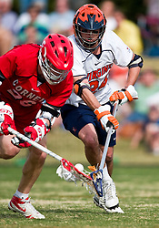 Cornell Big Red A Ryan Hurley (26) battles with Virginia Cavaliers D Ryan Nizolek (24) for a loose ball.  The #1 ranked Virginia Cavaliers defeated the #4 ranked Cornell Big Red 14-10 at Klockner Stadium on the Grounds of the University of Virginia in Charlottesville, VA on March 8, 2009.