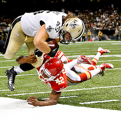 Aug 9, 2013; New Orleans, LA, USA; New Orleans Saints fullback Jed Collins (45) is upended by Kansas City Chiefs defensive back Otha Foster (42) during the second half of a preseason game at the Mercedes-Benz Superdome. The Saints defeated the Chiefs 17-13. Mandatory Credit: Derick E. Hingle-USA TODAY Sports