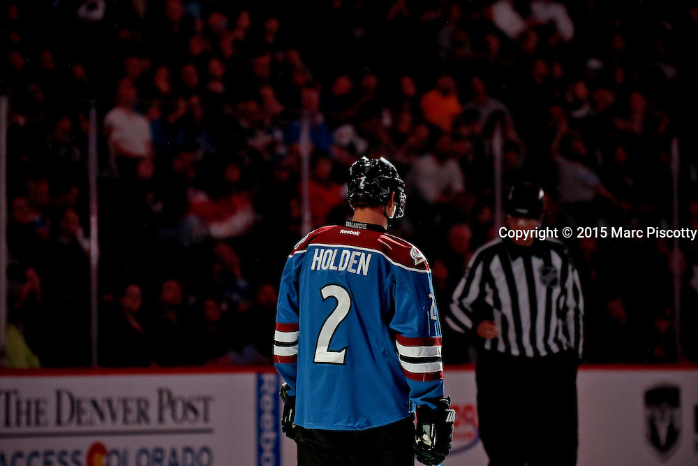 SHOT 3/28/15 7:05:12 PM - The Colorado Avalanche's Nick Holden #2 lines up for the national anthem prior to their game against the Buffalo Sabres at the Pepsi Center in Denver, Co. The Avalanche won the game 5-3. (Photo by Marc Piscotty / © 2015)