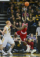 December 31 2012: Indiana Hoosiers guard Victor Oladipo (4) puts up a shot as Iowa Hawkeyes forward Aaron White (30) looks on during the first half of the NCAA basketball game between the Indiana Hoosiers and the Iowa Hawkeyes at Carver-Hawkeye Arena in Iowa City, Iowa on Monday December 31, 2012. Indiana defeated Iowa 69-65.