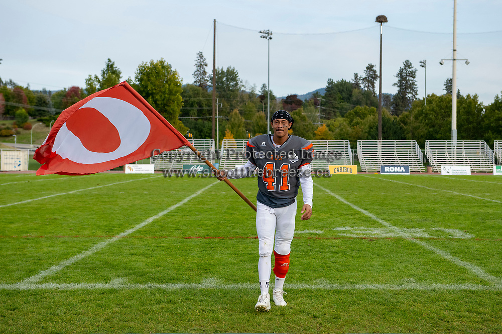 KELOWNA, BC - OCTOBER 6: Nate Adams #41 of Okanagan Sun stands on the field with a fan after the win against the VI Raiders at the Apple Bowl on October 6, 2019 in Kelowna, Canada. (Photo by Marissa Baecker/Shoot the Breeze)