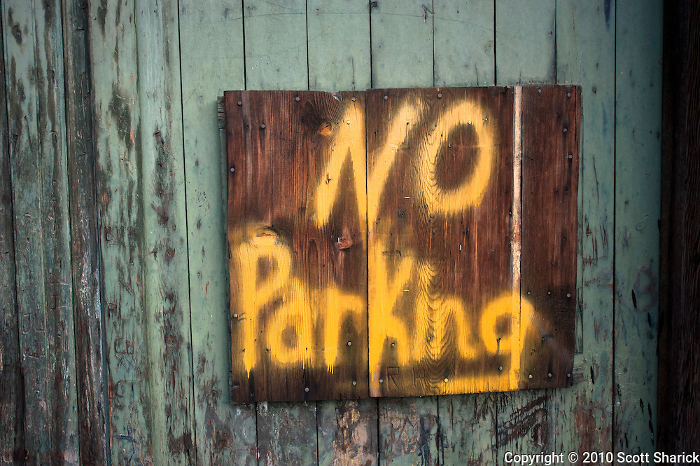 A hand painted  wooden 'No Parking' sign on an old wall. Missoula Photographer, Missoula Photographers, Montana Pictures, Montana Photos, Photos of Montana