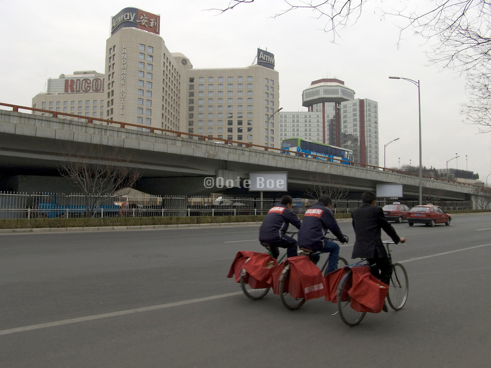 newspaper boys bicycling Beijing China