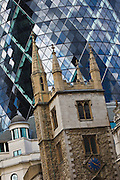The Swiss Re Building designed by Foster and Partners under construction 22 May 2003. It occupies the site of the former Baltic Exchange in the City of London and is described as the first environmentally progressive building in the capital. Also known as The Gerkin
