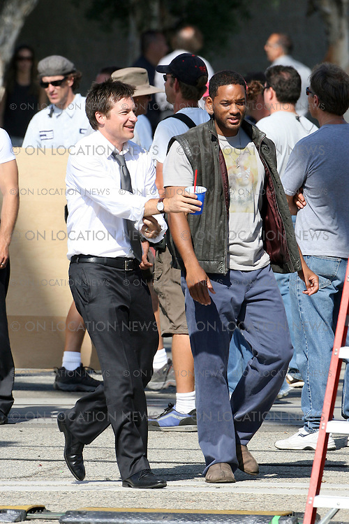 SAN PEDRO, CALIFORNIA - Monday July 30th 2007. NON EXCLUSIVE: Will Smith doing stunts on the set of his latest movie 'John Hancock'. Smith saves co-star Jason Bateman from a on coming train as his cars gets stuck on the tracks. Photograph: Buchan/Ford/On location News. Sales: Eric Ford 1/818-613-3955 info@onlocationnews.com