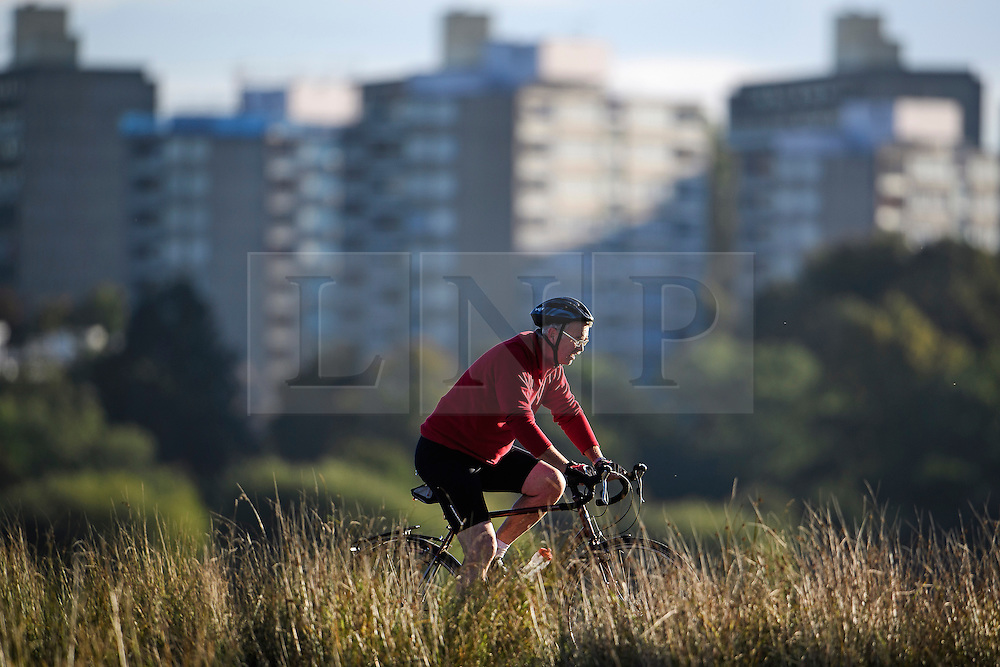 © Licensed to London News Pictures. 09/10/2016. London, UK. A man cycling on a bright autumnal morning in Richmond Park, London. . Photo credit: Ben Cawthra/LNP