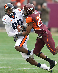 Virginia wide receiver Maurice Covington (80) is tackled by Virginia Tech cornerback Stephan Virgil (22) after a pass reception.  The Virginia Tech Hokies defeated the Virginia Cavaliers 17-14 in NCAA football at Lane Stadium on the campus of Virginia Tech in Blacksburg, VA on November 29, 2008.