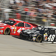 "Jimmie Johnson (48) and Juan Pablo Montoya speeds down the straight away during NASCAR SPRINT CUP ""AAA 400″ auto race at Dover International Speedway in Dover, DE Sunday,  Sept  29, 2013"