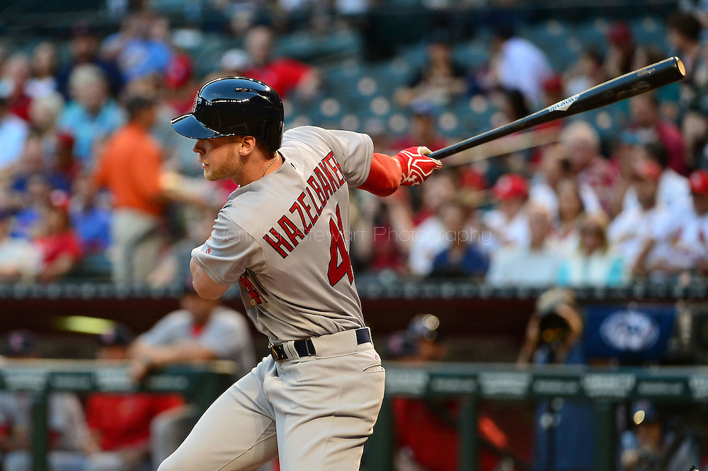 PHOENIX, AZ - APRIL 26:  Jeremy Hazelbaker #41 of the St. Louis Cardinals hits the ball against the Arizona Diamondbacks at Chase Field on April 26, 2016 in Phoenix, Arizona. The St Louis Cardinals won 8-2.  (Photo by Jennifer Stewart/Getty Images)