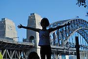 Child (6 years old) waving. Milsons Point, Sydney, Australia